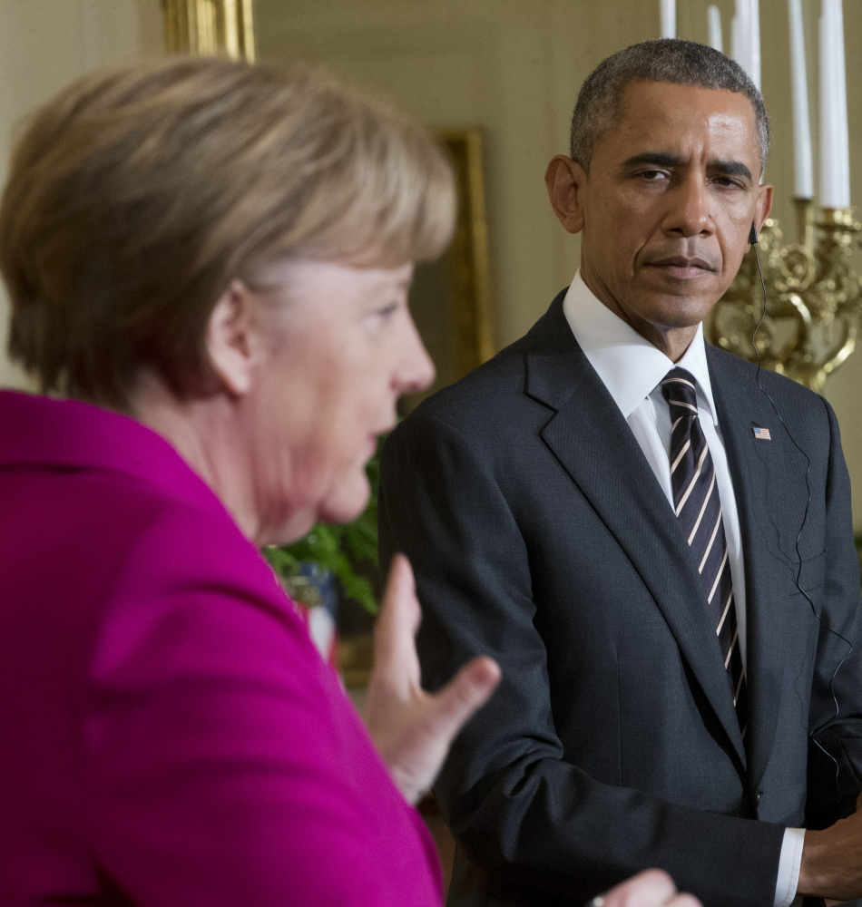 President Barack Obama says he's open to giving the Ukrainian government military support while German Chancellor Angela Merkel, left, said Monday she opposes the idea.