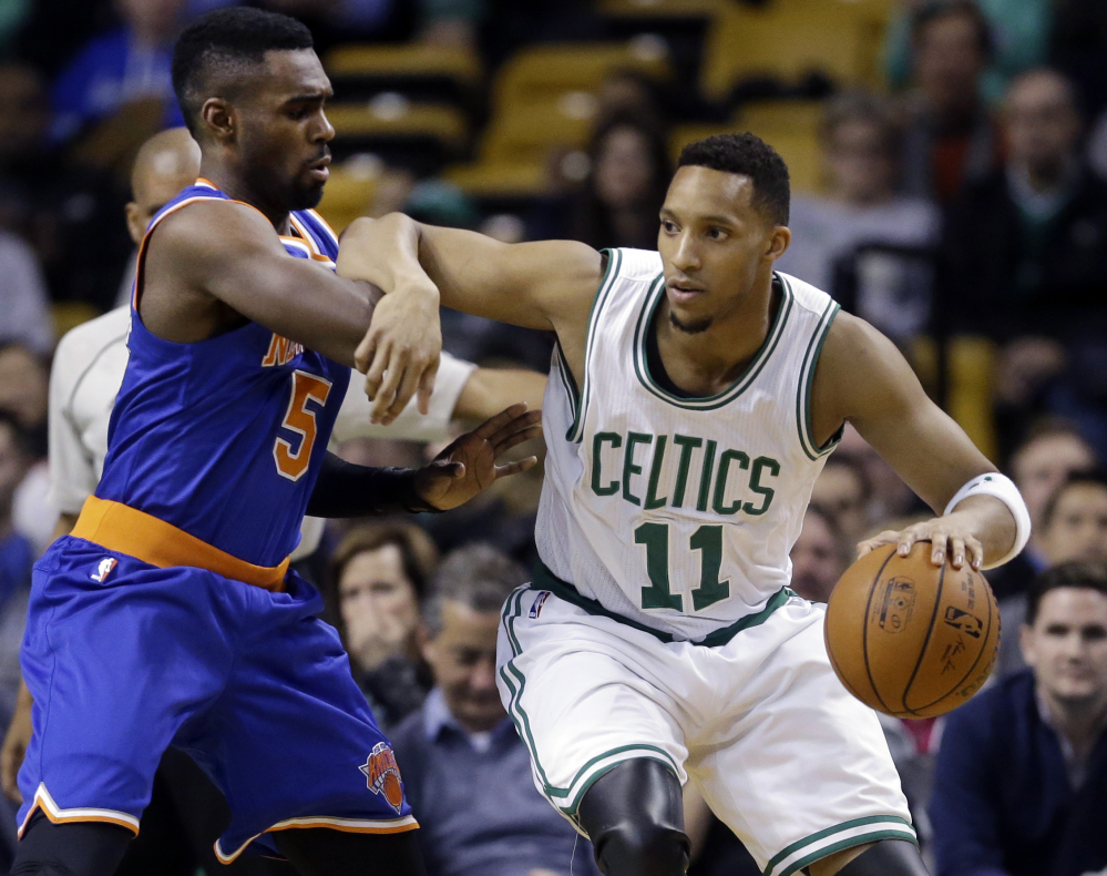Boston Celtics guard Evan Turner drives against New York Knicks guard Tim Hardaway Jr. during the first half of Wednesday night's game in Boston. Turner finished with 10 points, 12 rebounds and 10 assists for his first career triple-double.