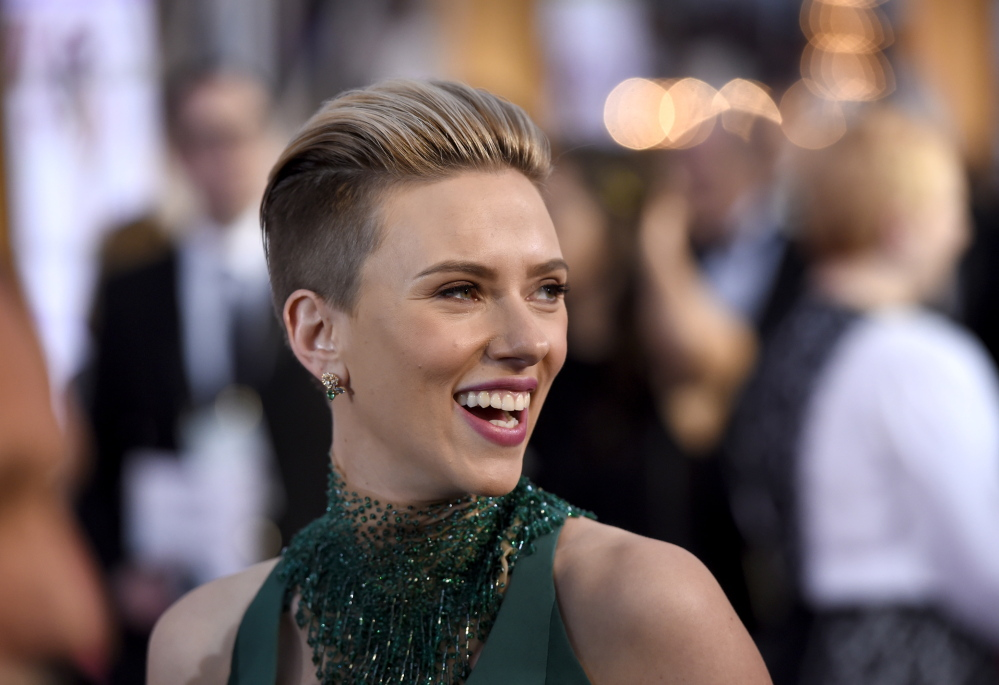 """Scarlett Johansson said John Travolta's gestures at the Oscars were """"very sweet and totally welcome."""""""