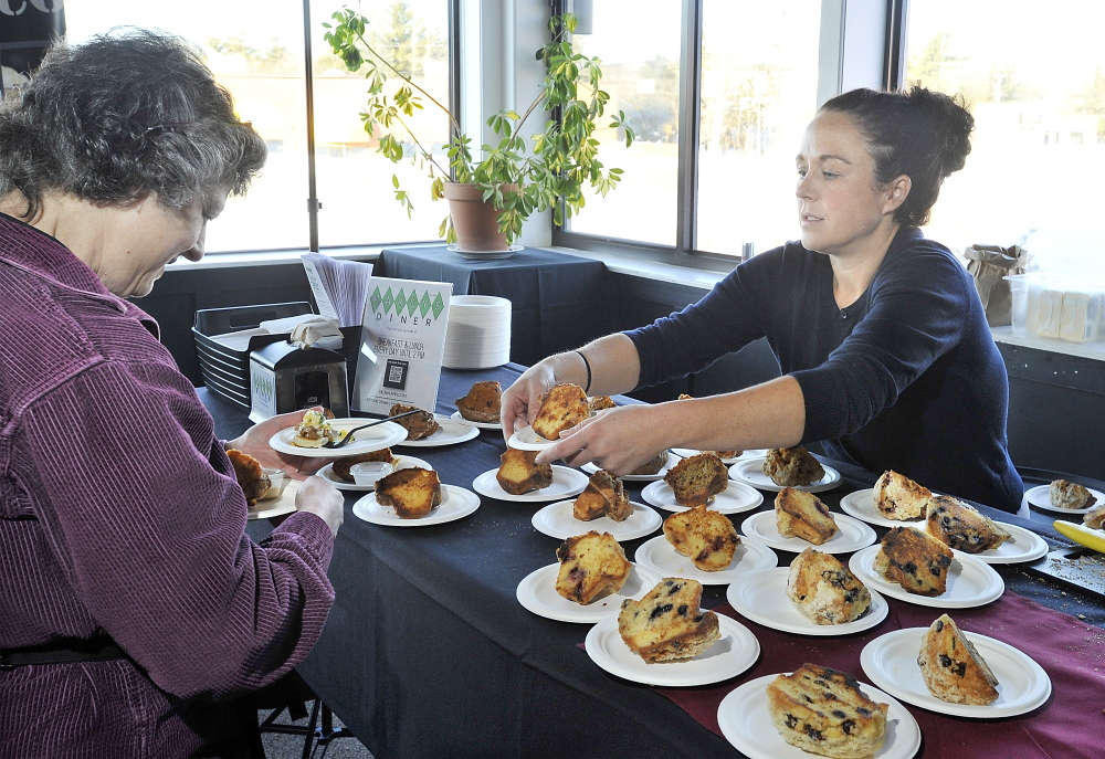 Alicia Gamow of Greene is offered a very tasty grilled muffin by Mandy Lacourse of Portland-based Marcy's Diner.