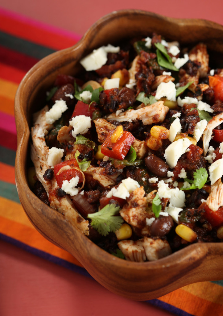 Black beans and black rice combine in a main dish that also packs in poblanos, corn, red peppers, queso fresco and more