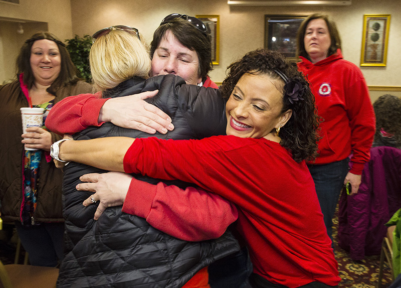 Fairpoint  employees hug during a meeting in Portland on Friday morning to vote on a prospective contract, ending four months of labor unrest.