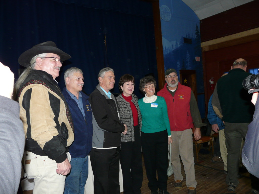 "U.S. Department of Agriculture Deputy Under Secretary for Natural Resources and Environment Arthur ""Butch"" Blazer; Sen. Tom Saviello, R-Wilton; Linkletter Timberlands President Richard Linkletter; U.S. Sen. Susan Collins; Nora Linkletter; and Rep. Russell Black, R-Wilton, join 120 supporters of economic development and preservation Saturday at the Phillips Area Community Center in Phillips to celebrate the Orbeton Stream Project conservation easement, completed in December."