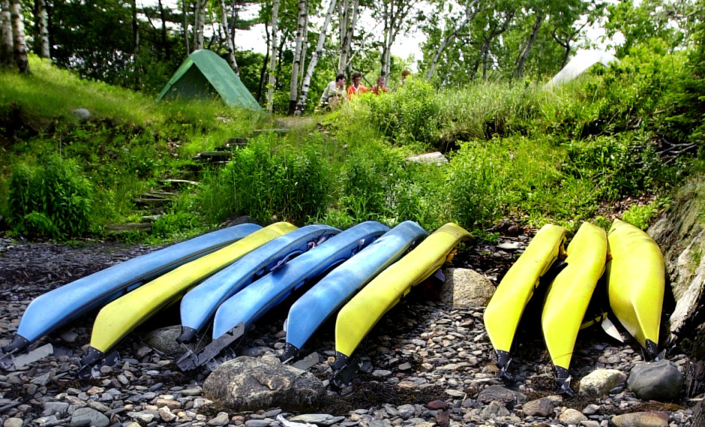 A group of kayakers parks for a couple days on Jewell Island.
