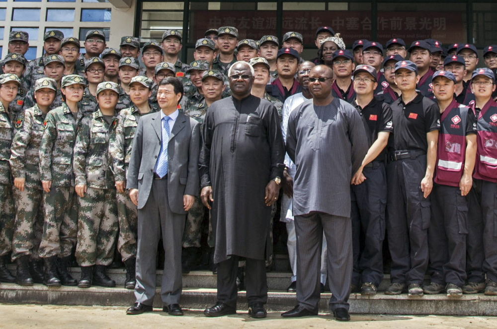 Sierra Leone Vice President Samuel Sam-Sumana, right, is seen at the opening of the China Friendship Hospital established for the care Ebola patients in Freetown, Sierra Leone last September. After a period of decline, the country last week had a rise in new Ebola cases.