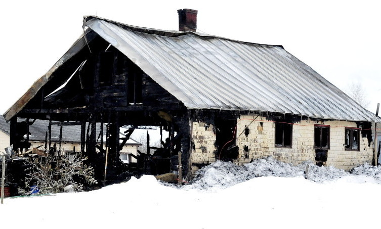 Fire destroyed this old farmhouse on the Weeks Mills Road in New Sharon on Friday, leaving the Tom Bailey family of seven homeless.