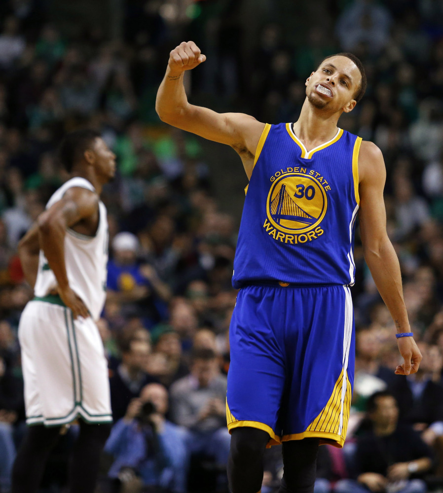 Golden State's Stephen Curry pumps his fist after hitting a three point basket during the second half of the Warriors 106-101 win over the Boston Celtics on Sunday in Boston.