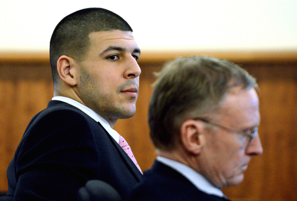 Former New England Patriots NFL football player Aaron Hernandez, left, sits with his attorney Charles Rankin during his murder trial at Bristol County Superior Court on Friday in Fall River, Mass. Hernandez is charged in the murder of Odin Lloyd in 2013.