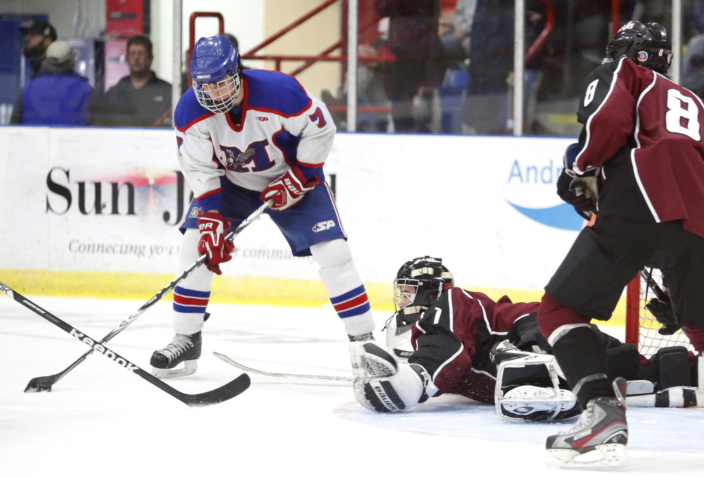 Justin Broy of Gorham hits the ice to block a shot attempt by Jake Dexter of Messalonskee last year in the Class B state championship game at the Colisee in Lewiston. The Eagles play Winslow on Tuesday night for the regional title and a shot to move on to the Class B title game in Lewiston. Messalonskee is on a 16-game win streak.