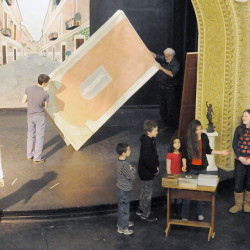 "Home-school students, right, rehearse Shakespeare's ""The Merchant of Venice"" Monday as sets are arranged on the stage at Cumston Hall in Monmouth. The play opens Thursday."