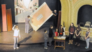 """Home-school students, right, rehearse Shakespeare's """"The Merchant of Venice"""" Monday as sets are arranged on the stage at Cumston Hall in Monmouth. The play opens Thursday."""