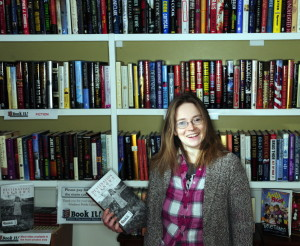 Deb Files stands in the Book It used-book shop inside Lisa's Legit Burritos in Gardiner on Tuesday. Files is one of 99 Kennebec County residents and organizations who were awarded Spirit of America Foundation awards Tuesday night.