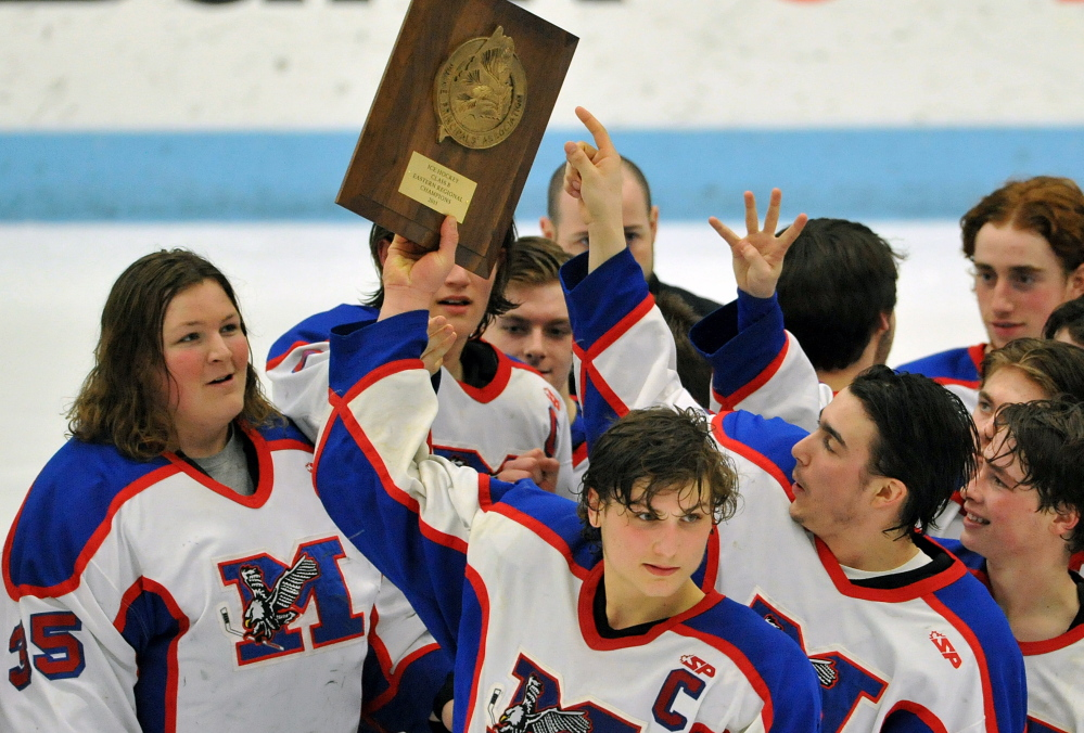Messalonskee High School celebrates after defeating Winslow 8-3 in the Eastern B title game Tuesday night in Alfond Arena at the University of Maine.
