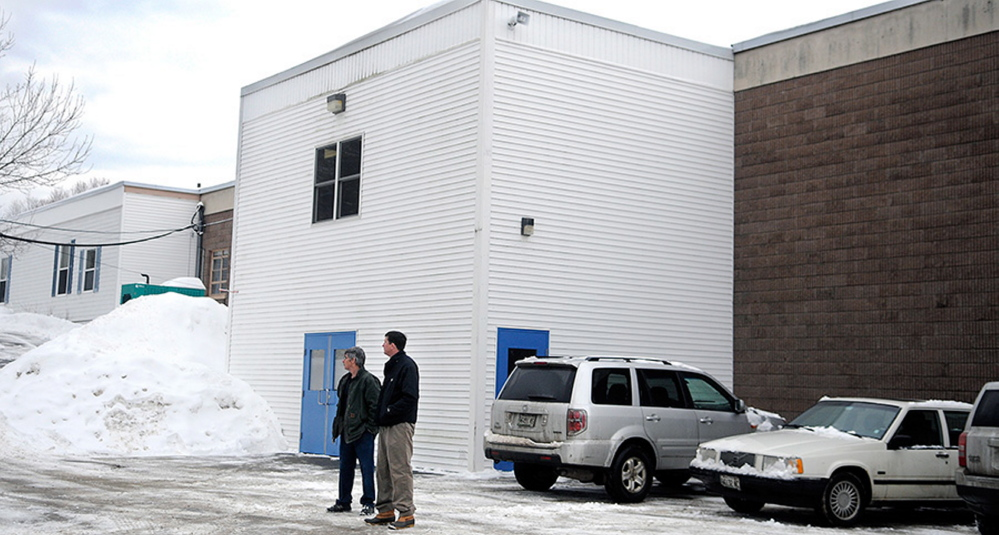 Bystanders wait Wednesday morning outside of the Teresa C. Hamlin School in Randolph, waiting for Kennebec County deputies to resolve a standoff with a man in a house near the school. School was canceled as a precaution and the standoff was over within an hour.