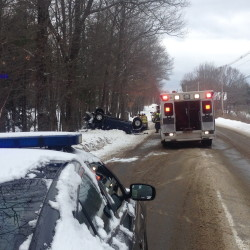A Toyota Tacoma rests on its roof after an attempted U-turn on a slippery and snowy Cushman Road  resulted in the vehicle rolling over. A 28-year-old Rome man went to the hospital for minor injuries.