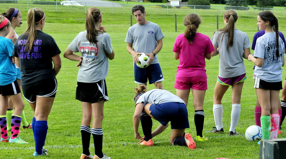 Waterville girls soccer coach Ian Wilson speaks with players during an Aug. 18 practice last year. Wilson told the team Wednesday he is stepping down as coach of the Panthers.