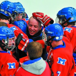 Members of the Messalonskee hockey team mob former coach Mike Latendresse after they defeated Brewer 5-2 in the 2012 Eastern B championship game at Alfond Arena in Orono.