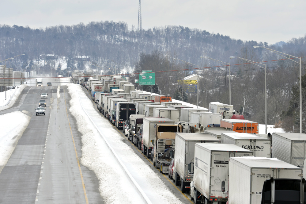 Traffic backs up as more than 50 miles of Interstate 65 southbound is shut down because of the weather on Thursday near Mount Washington, Ky. Kentucky State Police reported that the interstate will not reopen until Thursday evening.