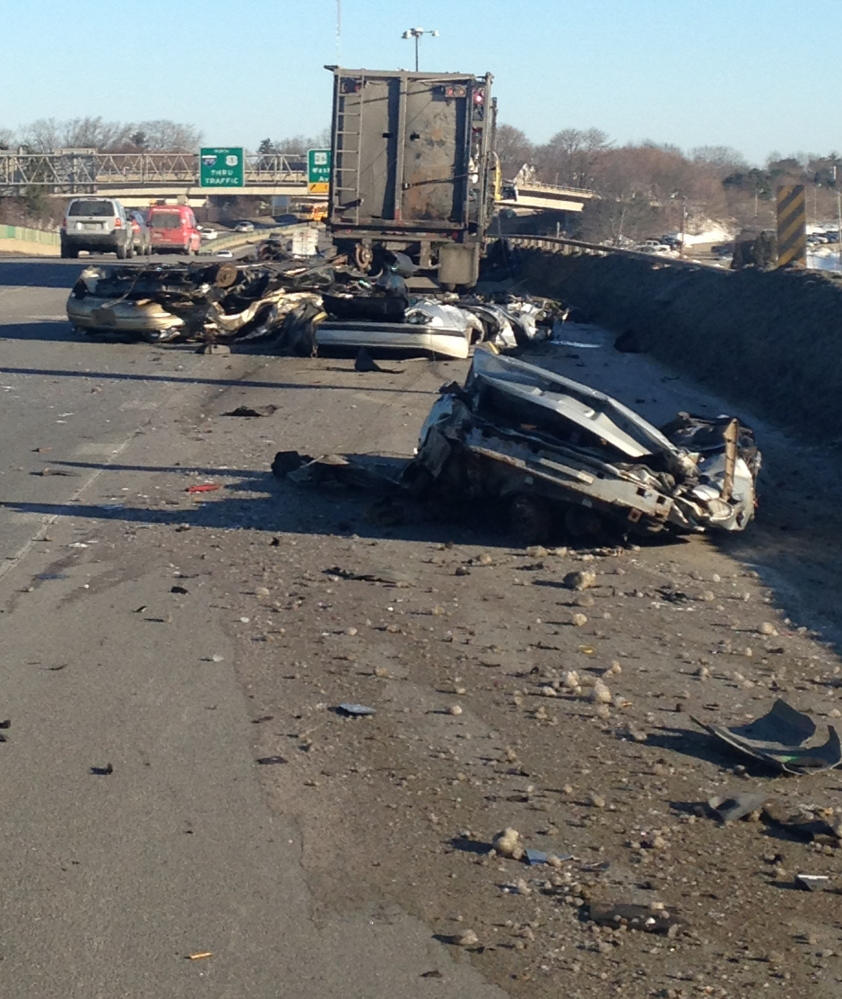 Morning traffic was backed up for miles after a tractor-trailer hauling crushed cars spilled part of its load onto Tukey's Bridge in Portland on Friday. The cars and debris were clared by 8:45 a.m.