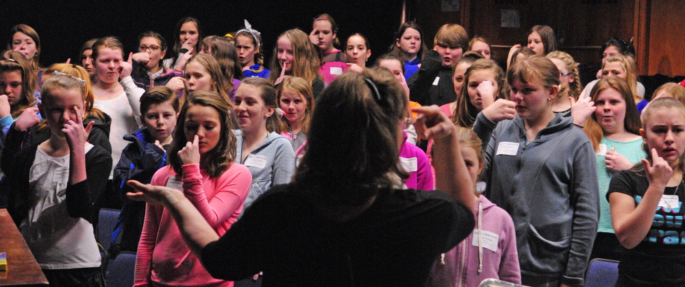 Conductor Nora Krainis leads the sixth grade honors chorus in warmups at the start of rehearsal on Friday at Gardiner Area High School. There were about 230 music students from 30 central Maine schools at the day-long District III Sixth Grade Honors Festival.