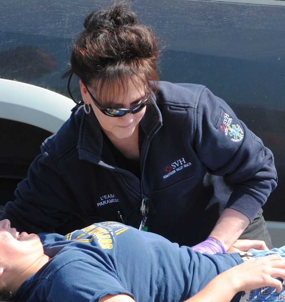 Sebasticook Valley Health EMS L'Easa Blaylock assists patients during recent mock disaster in Newport. The SVH EMS team was recently redesignated a Maine HeartSafe Community.