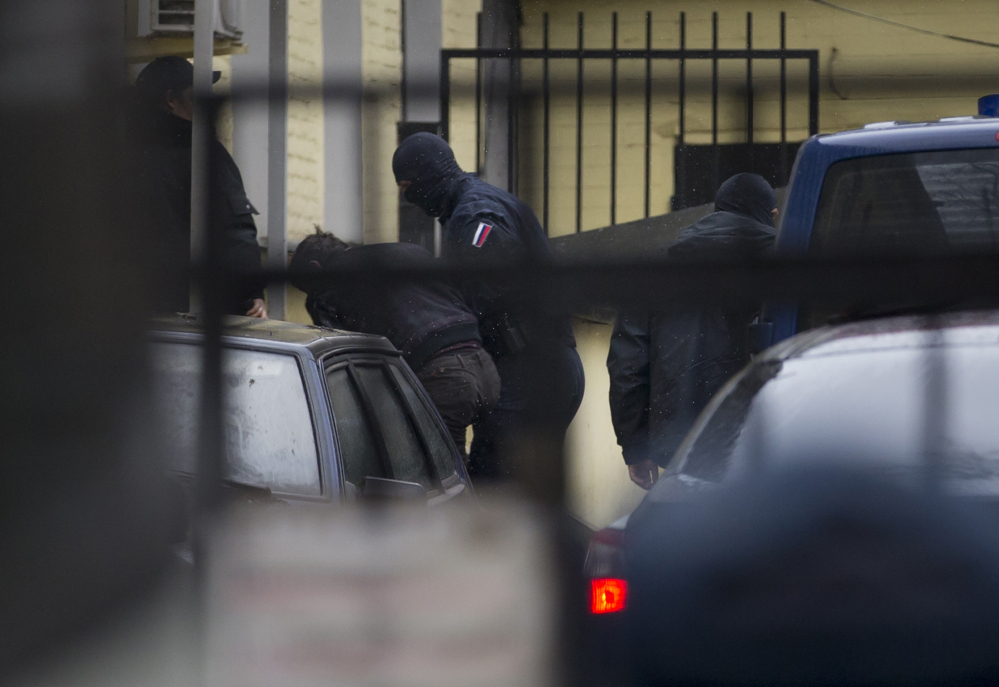 Police escort the suspects in the killing of Boris Nemtsov into a courthouse in Moscow on Sunday.