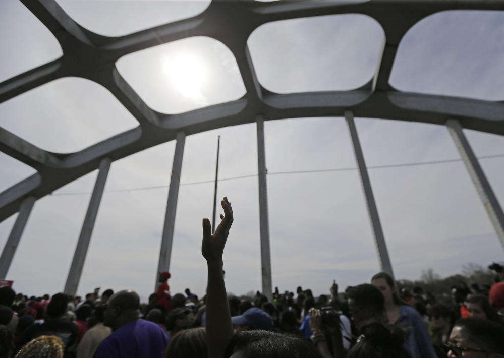 Crowds take a symbolic walk across the Edmund Pettus Bridge, Sunday, in Selma, Ala.