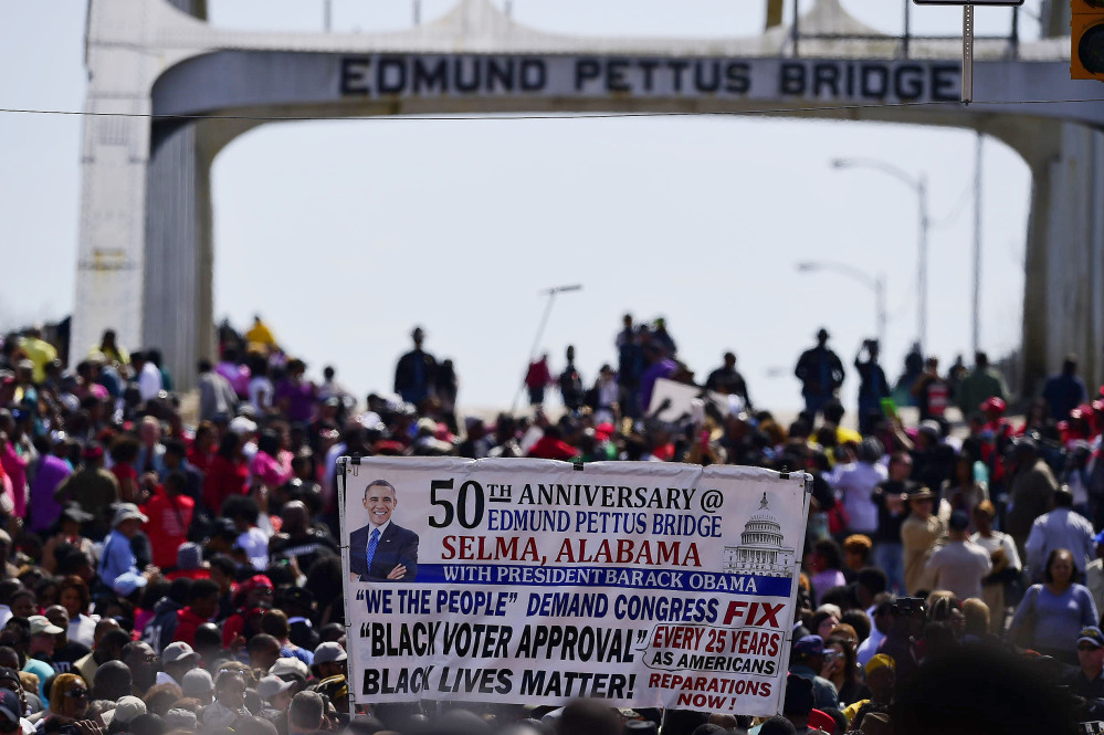 Crowds take a symbolic walk across the Edmund Pettus Bridge, Sunday in Selma, Ala.