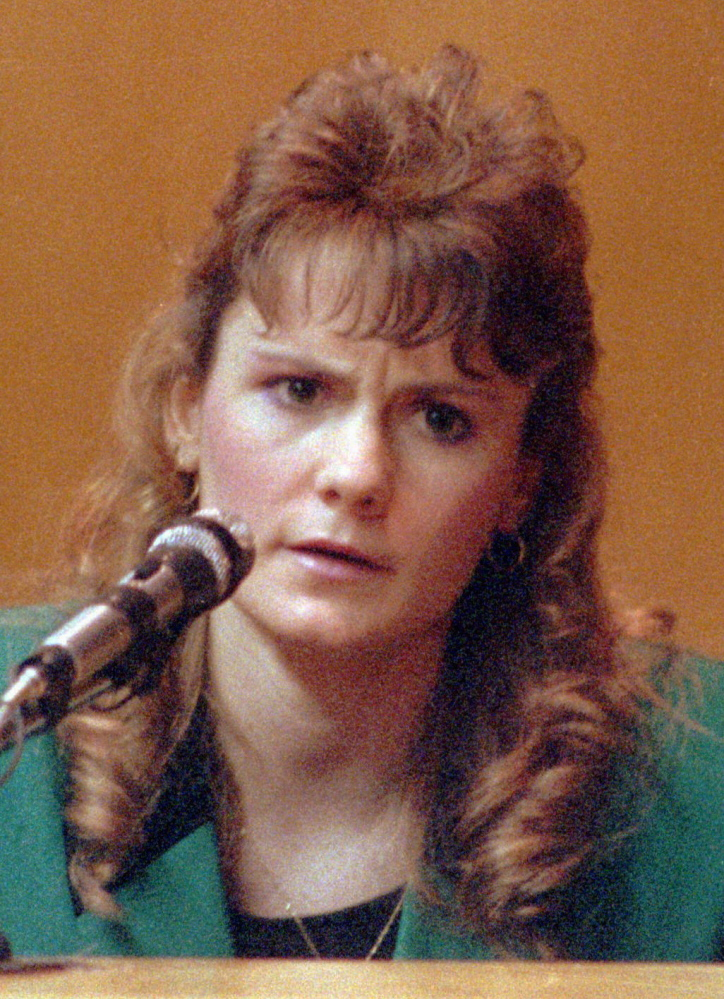 "FILE - In this 1991 file photo Pamela Smart, testifies in Rockingham County Superior Court in Exeter, N.H. Smart was convicted of conspiring with her 15 year-old lover, William ""Billy"" Flynn, to kill her 24 year-old husband, Greggory Smart, on May 1, 1990, in Derry, N.H. Smart is serving a life without parole sentence. Flynn pleaded guilty to killing her husband and has a parole hearing scheduled for Thursday, March 12, 2015. (AP Photo/Jim Cole, File)"