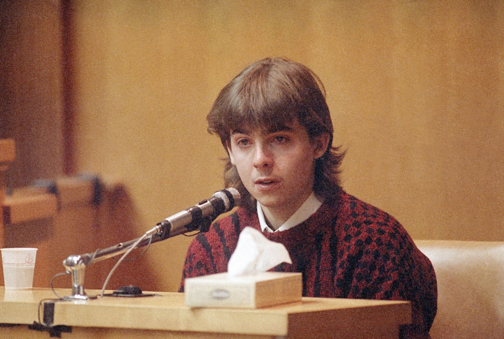 In this March 13, 1991 photo, William Flynn, testifies on his 17th birthday how he shot Gregory Smart in the head and killed him, in court in Exeter, N.H. Smarts' widow Pamela Smart was convicted and sentenced to life without parole for conspiring with Flynn to kill her husband. Flynn pleaded guilty to killing her husband and  has a parole hearing scheduled for Thursday.