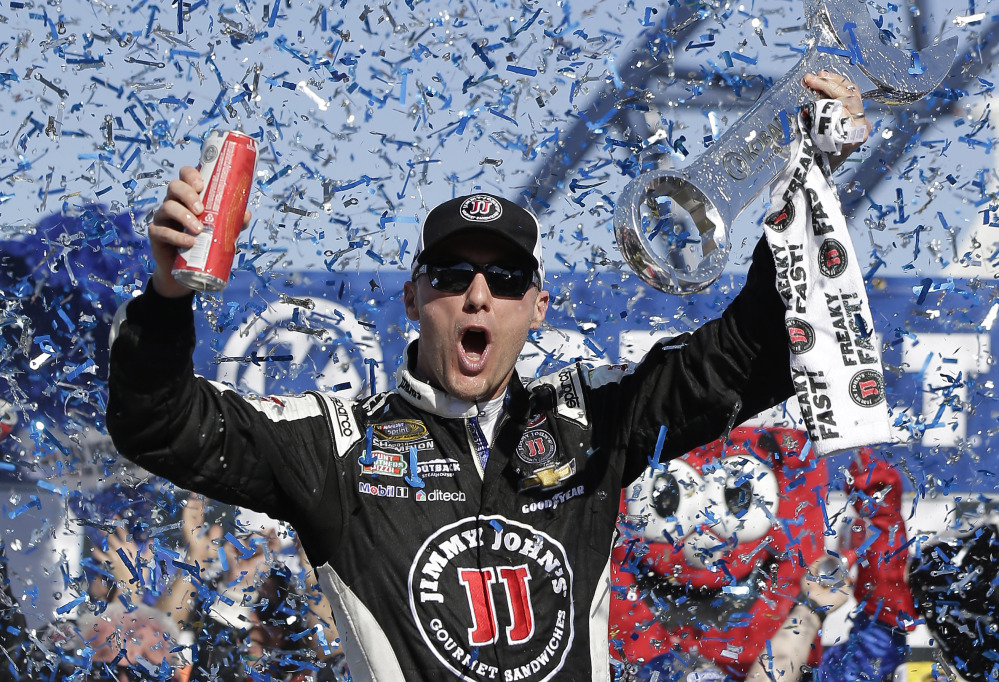 Kevin Harvick celebrates in Victory Lane after winning Sunday in Las Vegas. It's the first win of the season for the defending Sprint Cup champion.