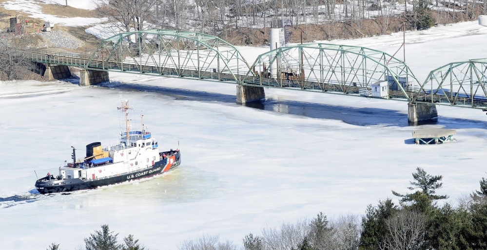 The 140-foot Coast Guard cutter Thunder Bay stops to turn around in this March 27, 2014, file photo near the old Richmond-Dresden Bridge on the Kennebec River.