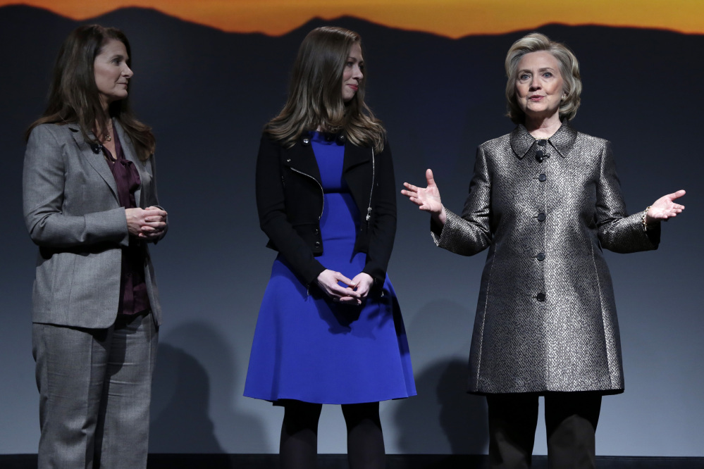 """Melinda Gates, left, Chelsea Clinton, center, and Hillary Rodham Clinton participate in the """"No Celings: The Full Participation Project,"""" in New York, Monday."""