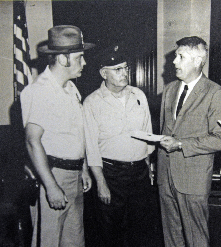 This undated handout photo shows, from left, Augusta police Officer Charles Winslow, Augusta firefighter Laurier Jacques and Gov. Ken Curtis.