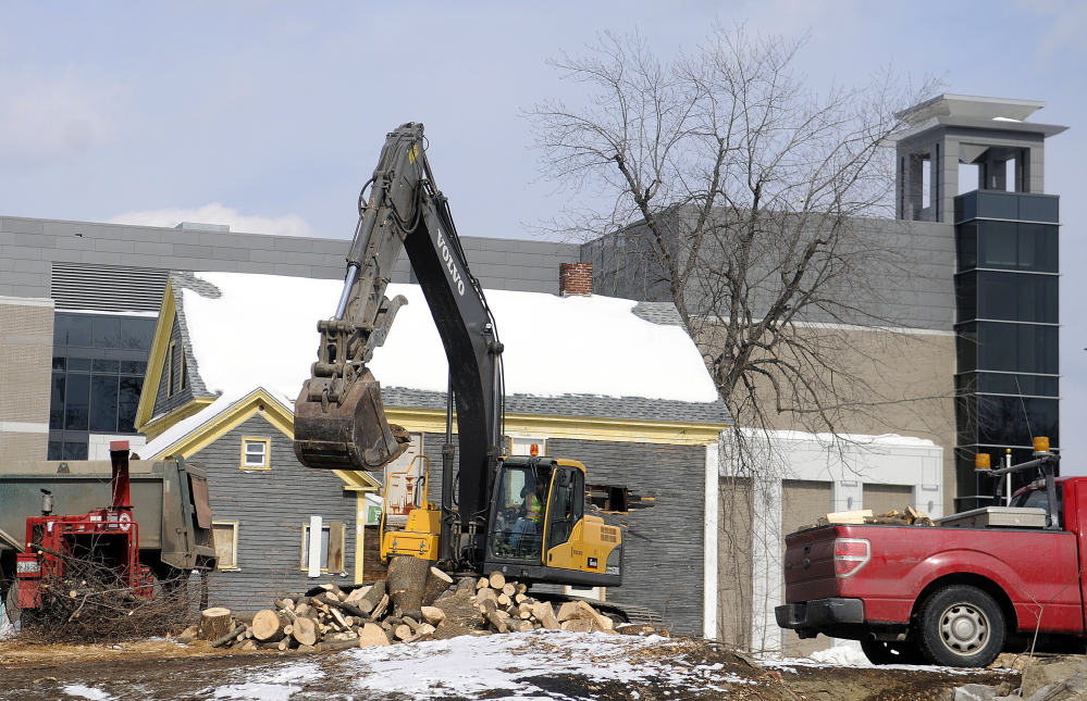 With the new courthouse in the background, this March 2 file photo shows one of four homes along Perham Street that was torn down to make way for more parking.