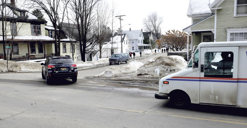 Vehicles turn onto Quebec Street off Perham Street in Farmington on Tuesday. Members of the Farmington Planning Board will meet at the intersection next week to observe a large truck negotiating the intersection to see what effect many trucks delivering wood chips to the nearby biomass boiler system planned by the University of Maine in Farmington would have on the neighborhood.