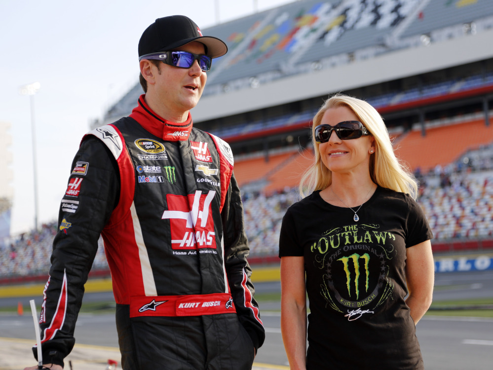 Kurt Busch, left,  has been reinstated by NASCAR and can participate in the Chase for the Sprint Cup championship should he qualify. Busch had been suspended for a possible domestic violence act against former girlfriend Patricia Driscoll, right.