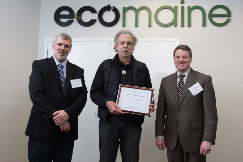 Waterville resident Stu Silverstein, center, accepts the 2015 eco-Excellence Award from ecomaine Recycling Committee Chairman Erik Street, left, and ecomaine CEO Kevin Roche.