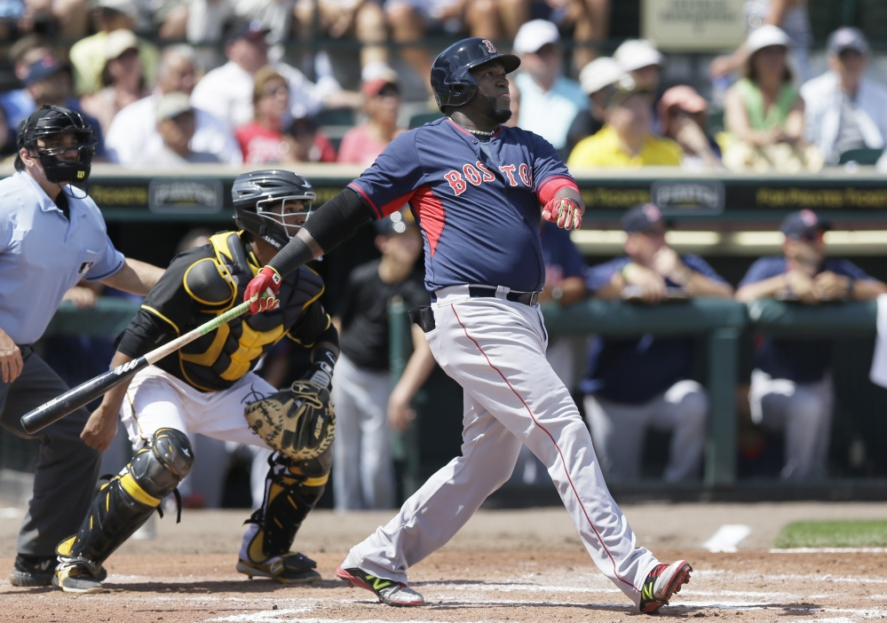 Boston Red Sox designated hitter David Ortiz watches his three-run home run clear the center field wall Thursday during the third inning against the Pittsburgh Pirates in Bradenton, Fla.. The Red Sox defeated the Pirates 5-1.