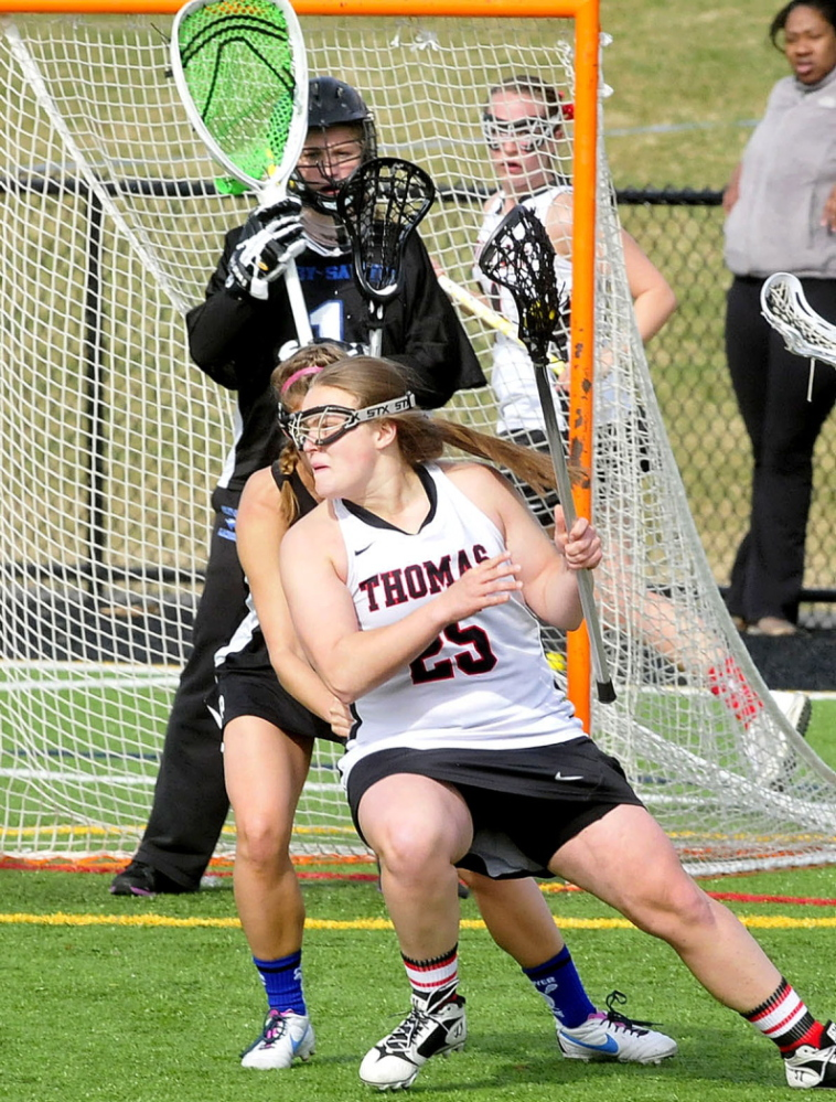 Thomas College player Jennifer Day (25) evades pressure from Colby-Sawyer players near the goal during a game last season.