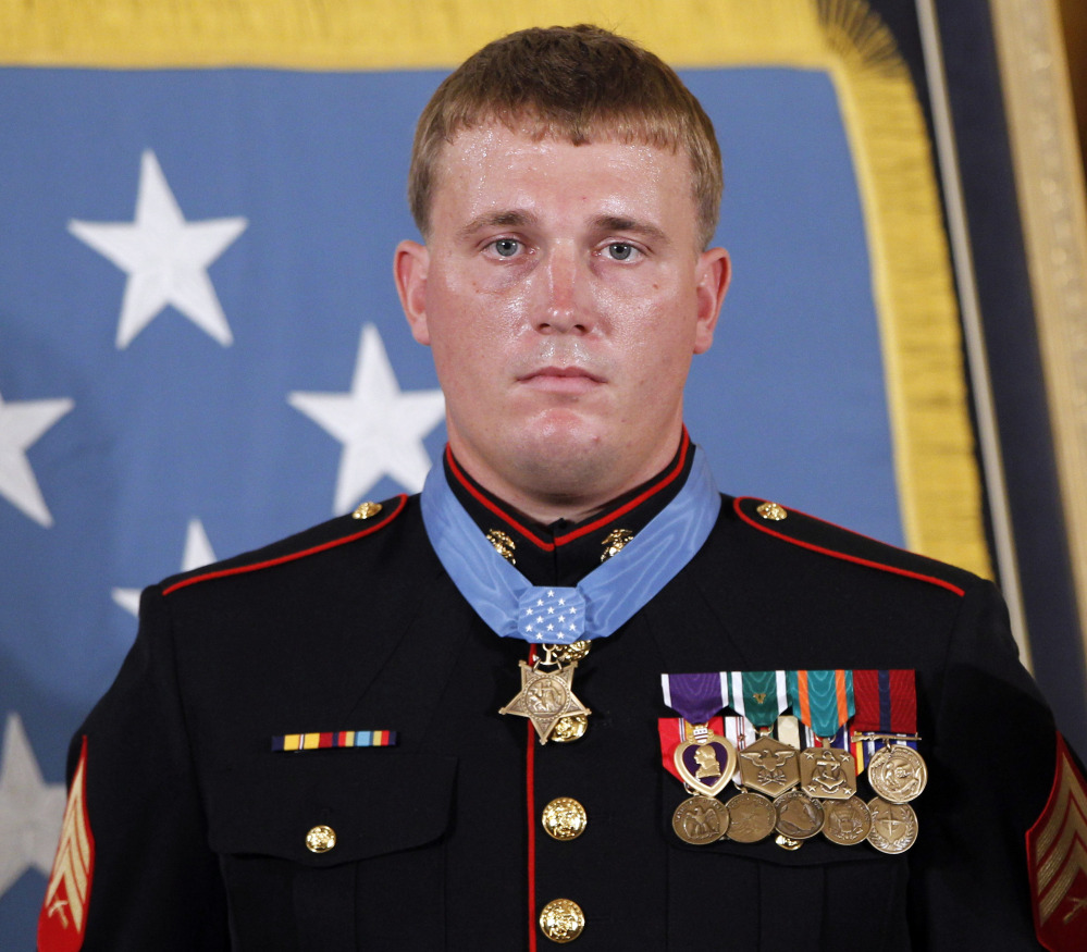 In this Sept. 15, 2011 file photo, former Marine Cpl. Dakota Meyer, 23, from Greensburg, Ky, poses with the Medal of Honor after it was awarded to him by President Barack Obama during a ceremony at the White House in Washington, D.C.