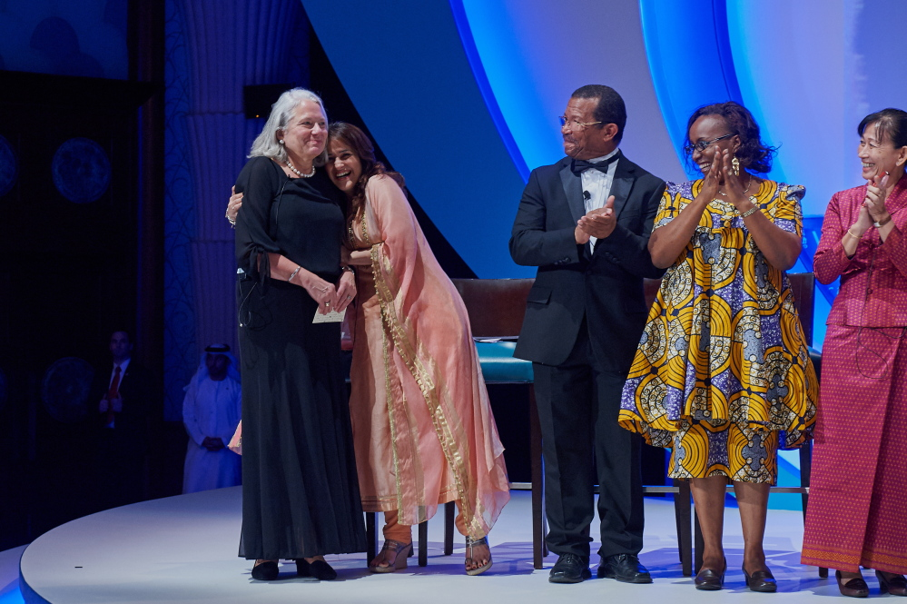 Nancie Atwell, a teacher at The Center for Teaching and Learning in Edgecomb,  is congratulated by Kiran Bir Sethi, a top 10 finalist of the Global Teacher Prize from India. Also pictured are Guy Etienne from Haiti, Jacque Kahura from Kenya, and Neang Phalla from Cambodia.