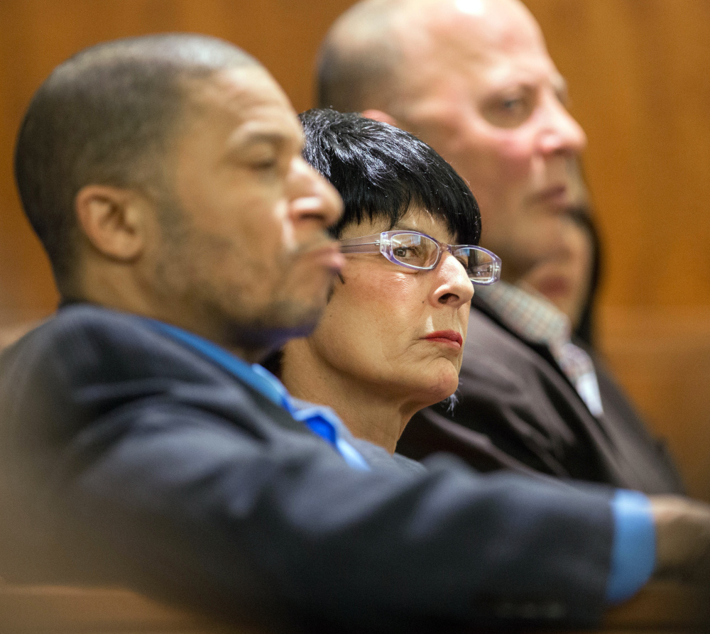 Terri Hernandez, right, listens during the trial of her son, former New England Patriots football player Aaron Hernandez, on Tuesday in Fall River, Mass.