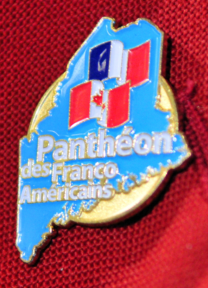 Maurice Pelletier of Augusta wears a pin that shows he was one of five new inductees into the Pantheon des Franco Americains, or Franco-American Hall of Fame, during Franco-American Day events on Wednesday in the State House Hall of Flags.