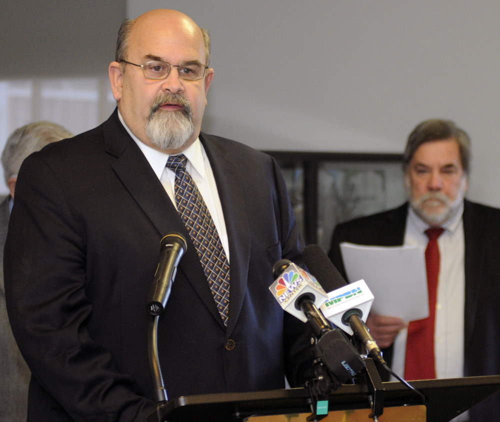 """Augusta Mayor David Rollins speaks during a news conference hosted by the Mayors' Coalition on Jobs and Economic Development, where they released a plan, """"Cities of the Future,"""" on Wednesday at the State House. Gardiner Mayor Thom Harnett is in the background."""