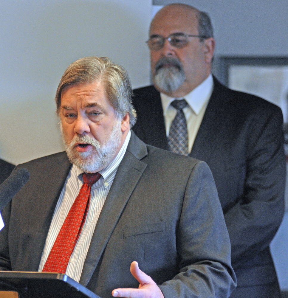 """Gardiner Mayor Thom Harnett speaks during a news conference by the Mayors' Coalition on Jobs and Economic Development, where they released a plan, """"Cities of the Future,"""" on Wednesday in the State House in Augusta. Augusta Mayor David Rollins is in the background."""