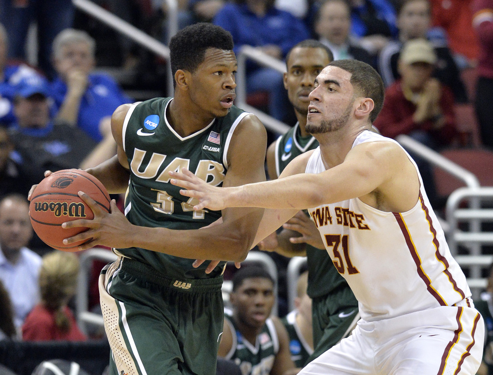 UAB's William Lee, left, looks for help from the defense of Iowa State's Georges Niang during the second half Thursday of an NCAA tournament game in Louisville, Ky. UAB won 60-59.