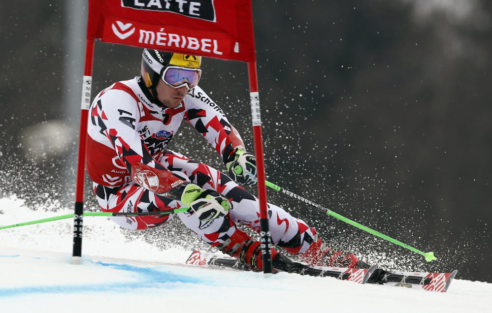 Marcel Hirscher, of Austria, powers past a gate during the first run of the men's World Cup giant slalom race at the World Cup finals in Meribel, France, on Saturday.