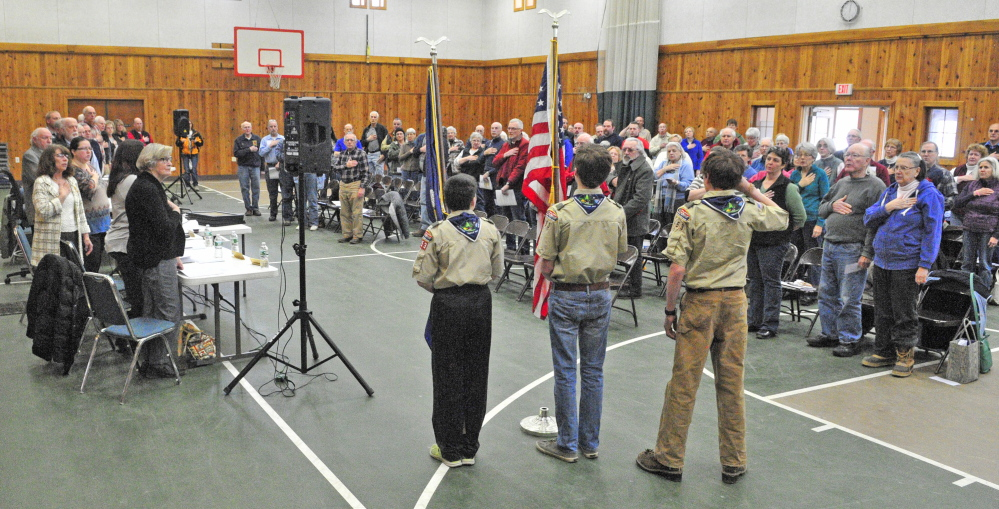 Boy Scouts from Troop 453 present the colors and lead the Pledge of Allegiance on Saturday to start the Belgrade Town Meeting at the Center For All Seasons in Belgrade.