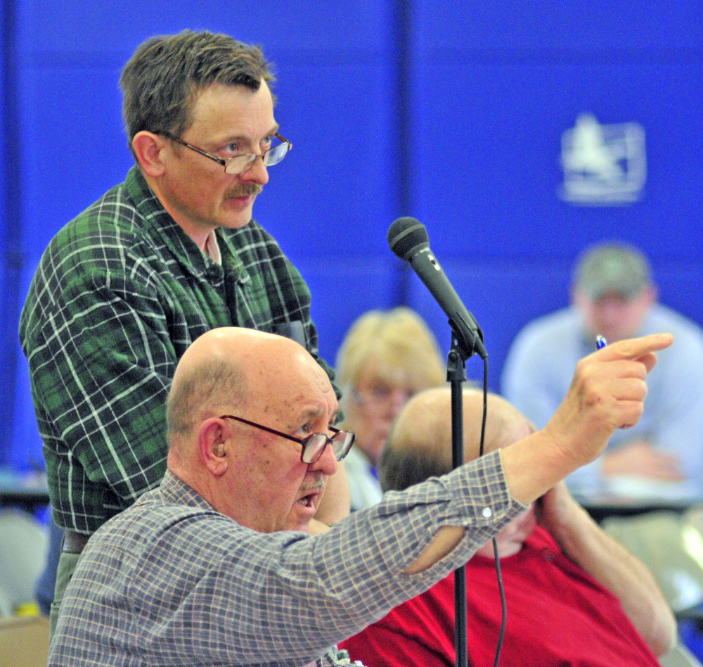TIm Lawrence, top, and Robert Bender participate in the debate Saturday during the Pittston Town Meeting at the Pittston Consolidated School.